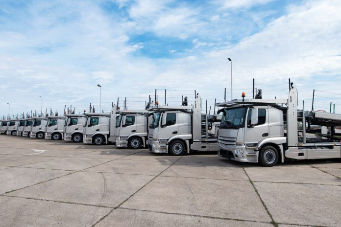 White Semi Trucks In a Row